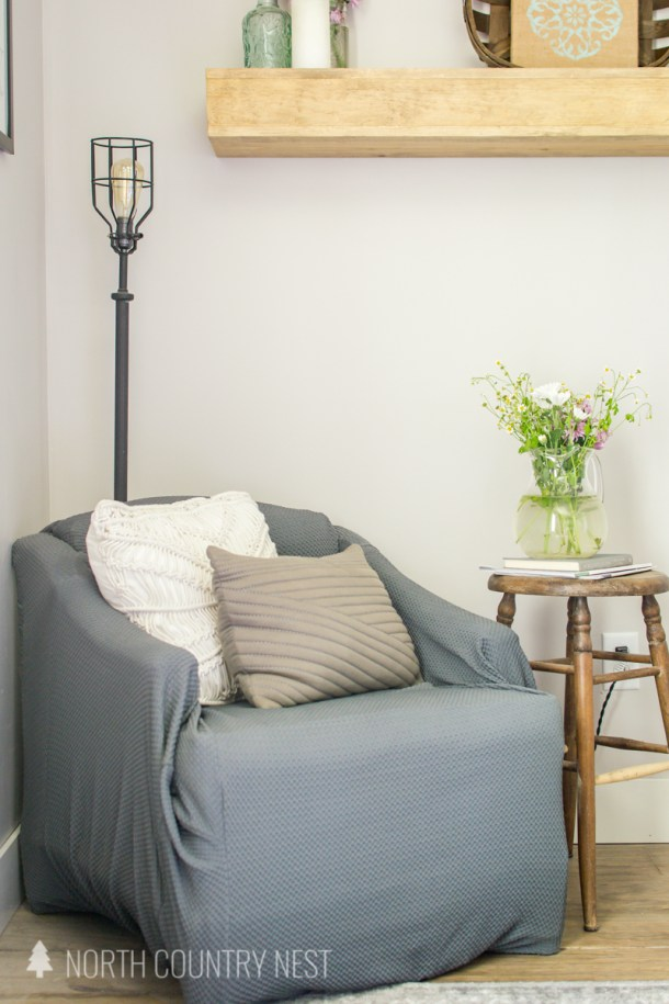 guest bedroom reading nook with industrial light