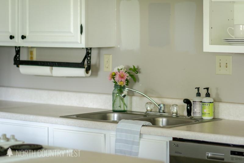kitchen sink with mason jar of fresh flowers