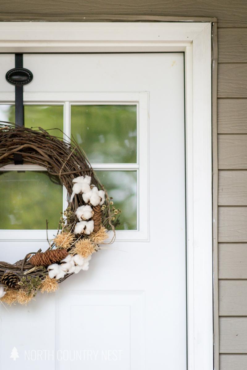fall wreath on white door