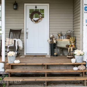 front porch with white door
