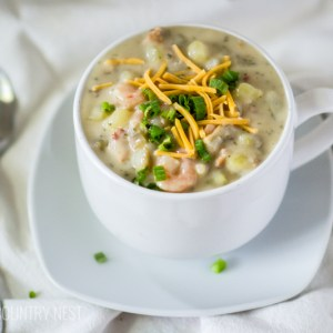 soup in white bowl on linen cloth