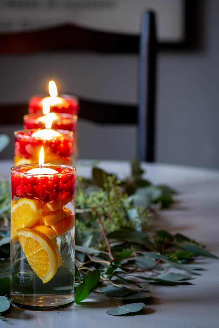 cranberries, oranges and eucalyptus kitchen table centerpieces