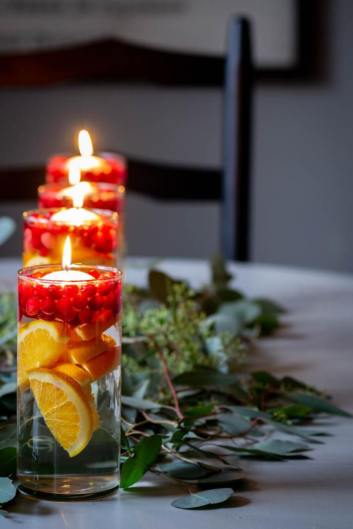 cranberries, oranges and eucalyptus kitchen table centerpieces