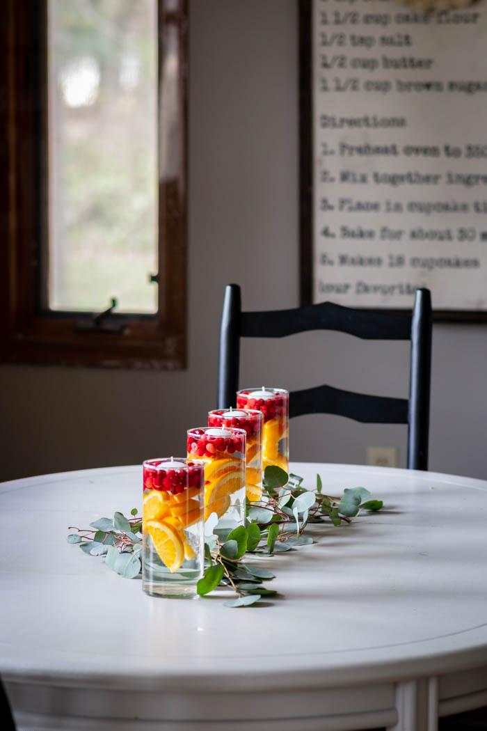 orange, cranberry and eucalyptus kitchen table centerpiece