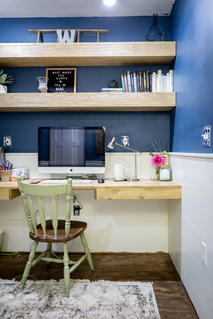 floating shelves and desk in home office