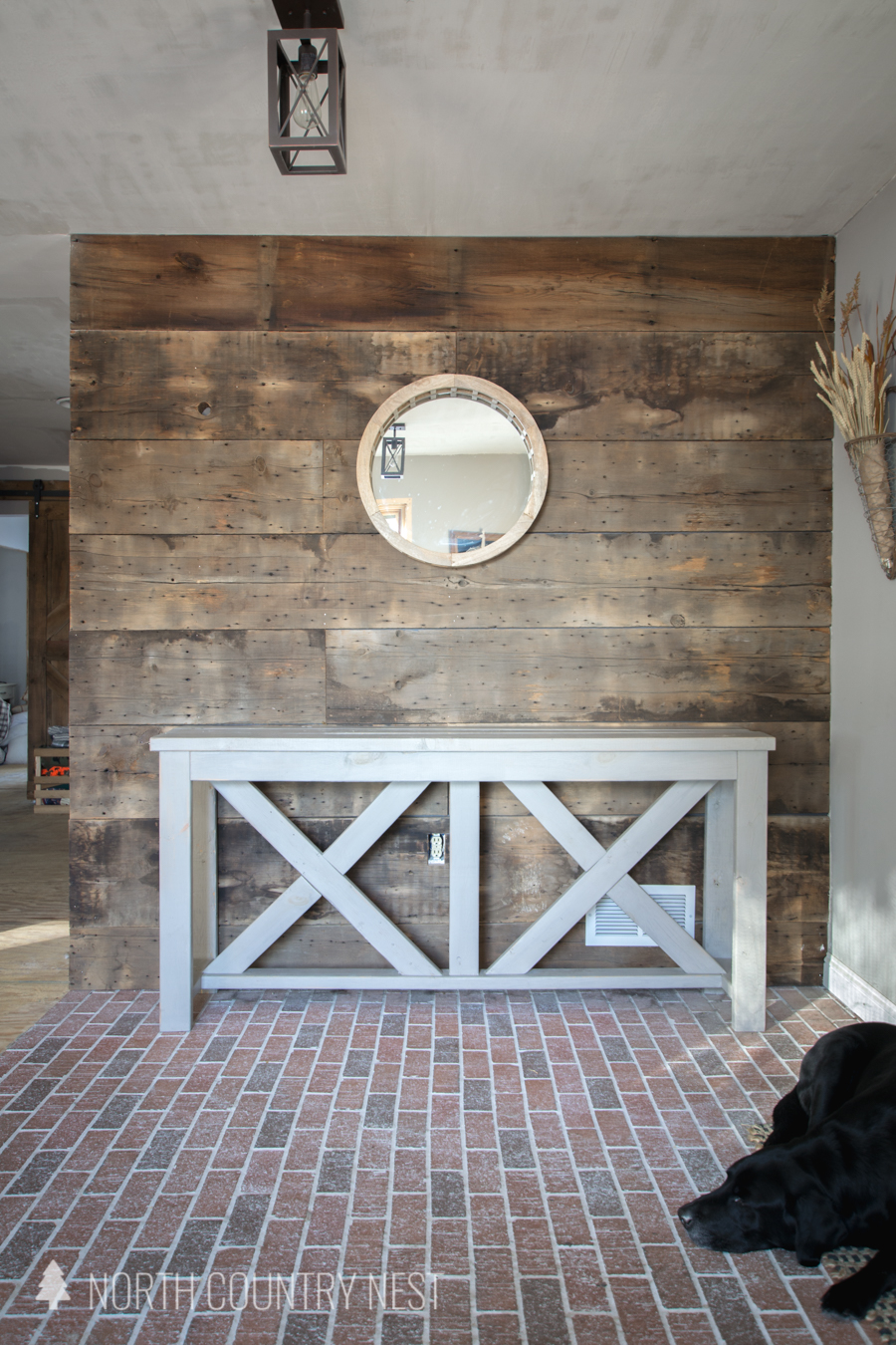 Entryway table with mirror on barnwood wall