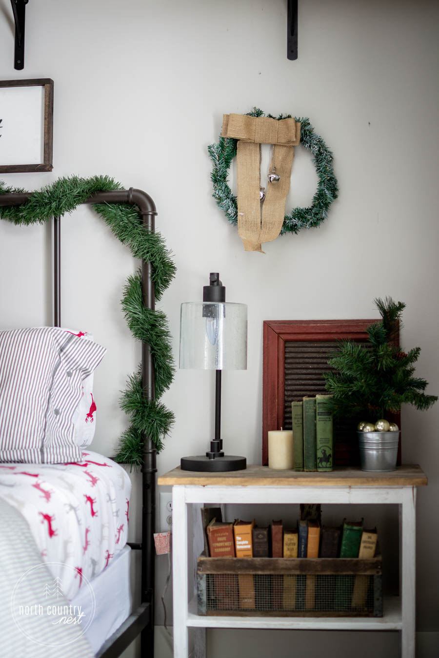 guest bedroom side table with christmas decor