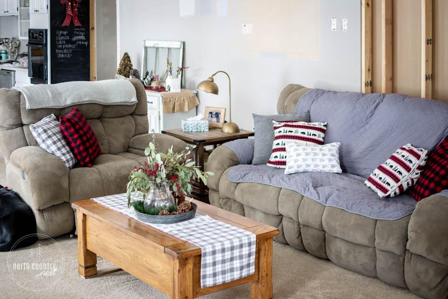 couches with buffalo check throw pillows