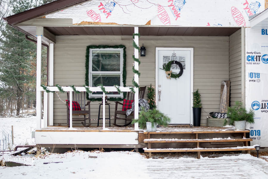 rustic front porch with christmas decor