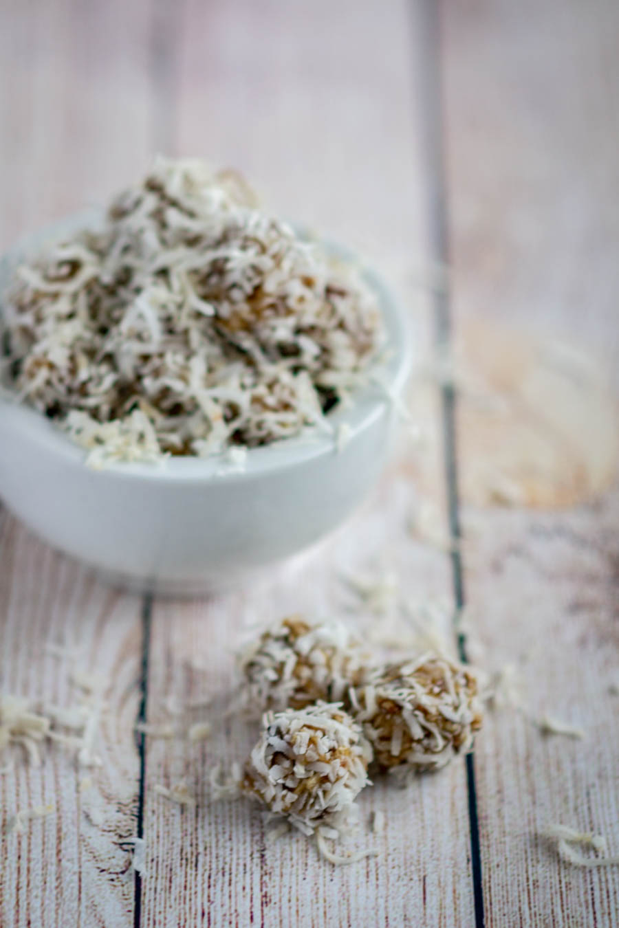crunchy gluten free date balls in white bowl