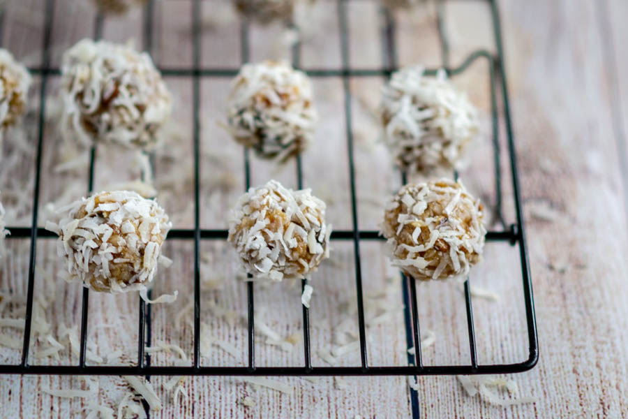 crunchy gluten free date balls on cooling rack