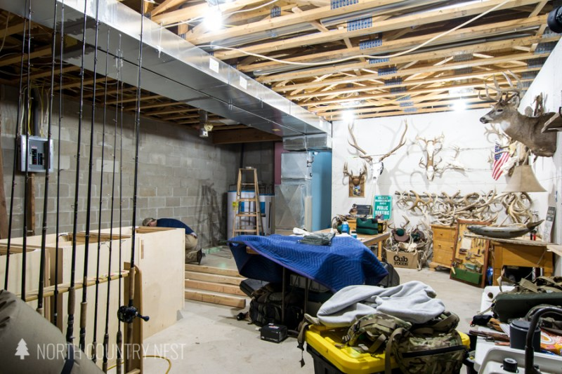 unfinished basement with deer antlers