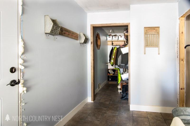 industrial rustic mudroom closet with wood door frame