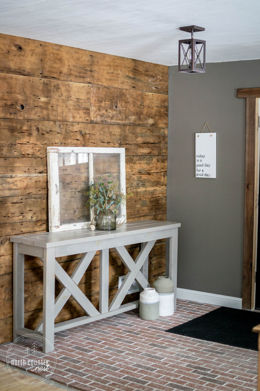 barn wood wall in modern rustic entryway