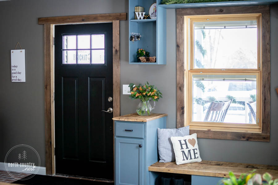 modern rustic entryway with black interior door