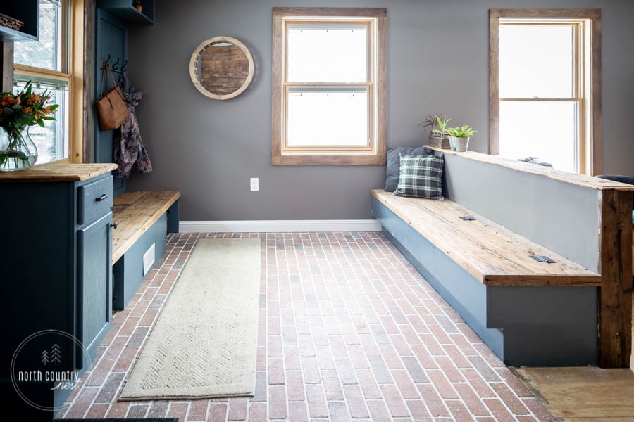 modern rustic entryway built ins and brick floor