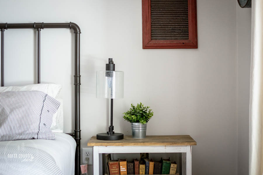 spring bedroom decor with industrial lamp