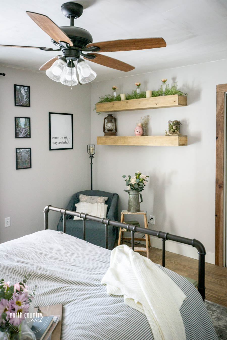 spring bedroom reading nook with floating shelves