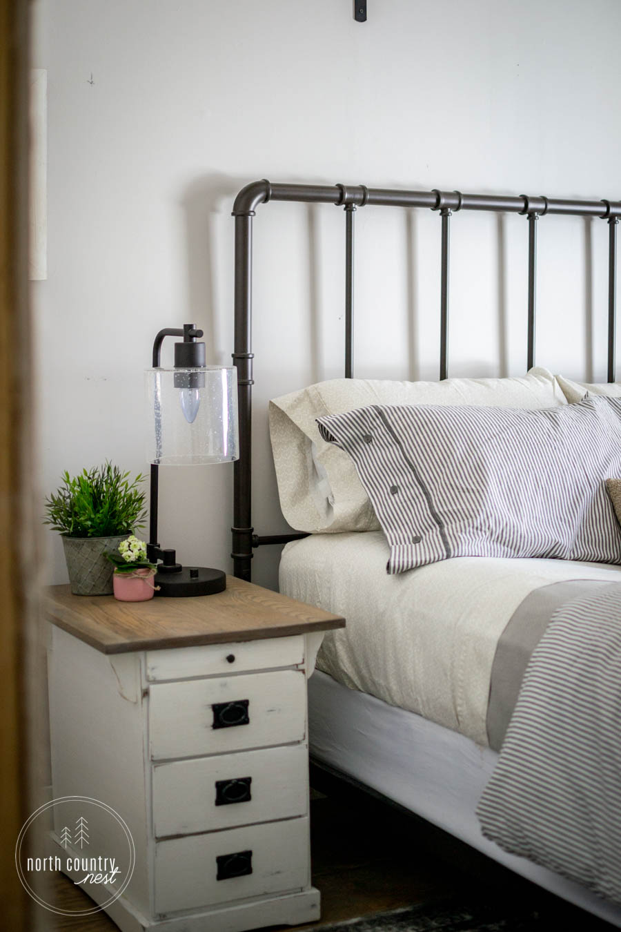 farmhouse nightstand in spring bedroom