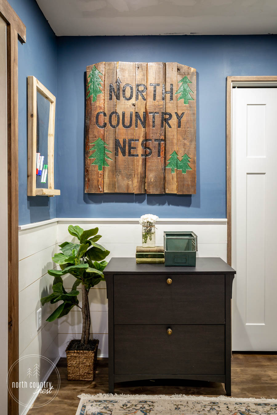 rustic home office with lateral filing cabinet and faux plant