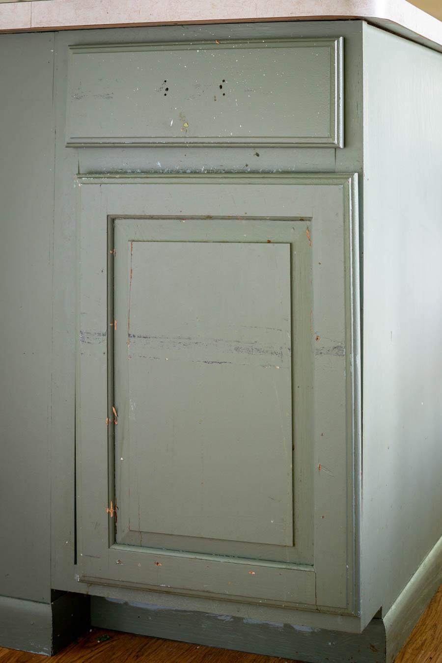 green kitchen island garbage cabinet door front