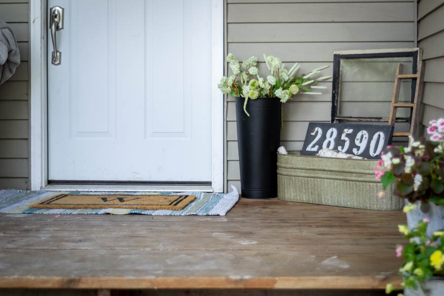colorful summer front porch decor with black accents