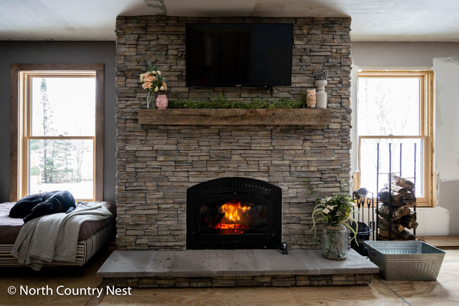Rustic fireplace mantle decorated for spring