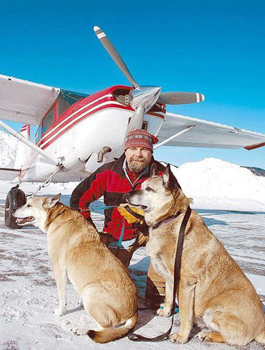 "D.J. O'Neill of Lake Placid, with his Cessna 185 Skywagon I and his dogs Chaka and Zozo, flies his airplane to locations throughout the Northeast to rescue dogs and bring them to no-kill shelters or adoptive families. Photo: Chris Morris, courtesy <a href=""http://www.adirondackdailyenterprise.com/""><em>Adirondack Daily Enterprise</em></a>"