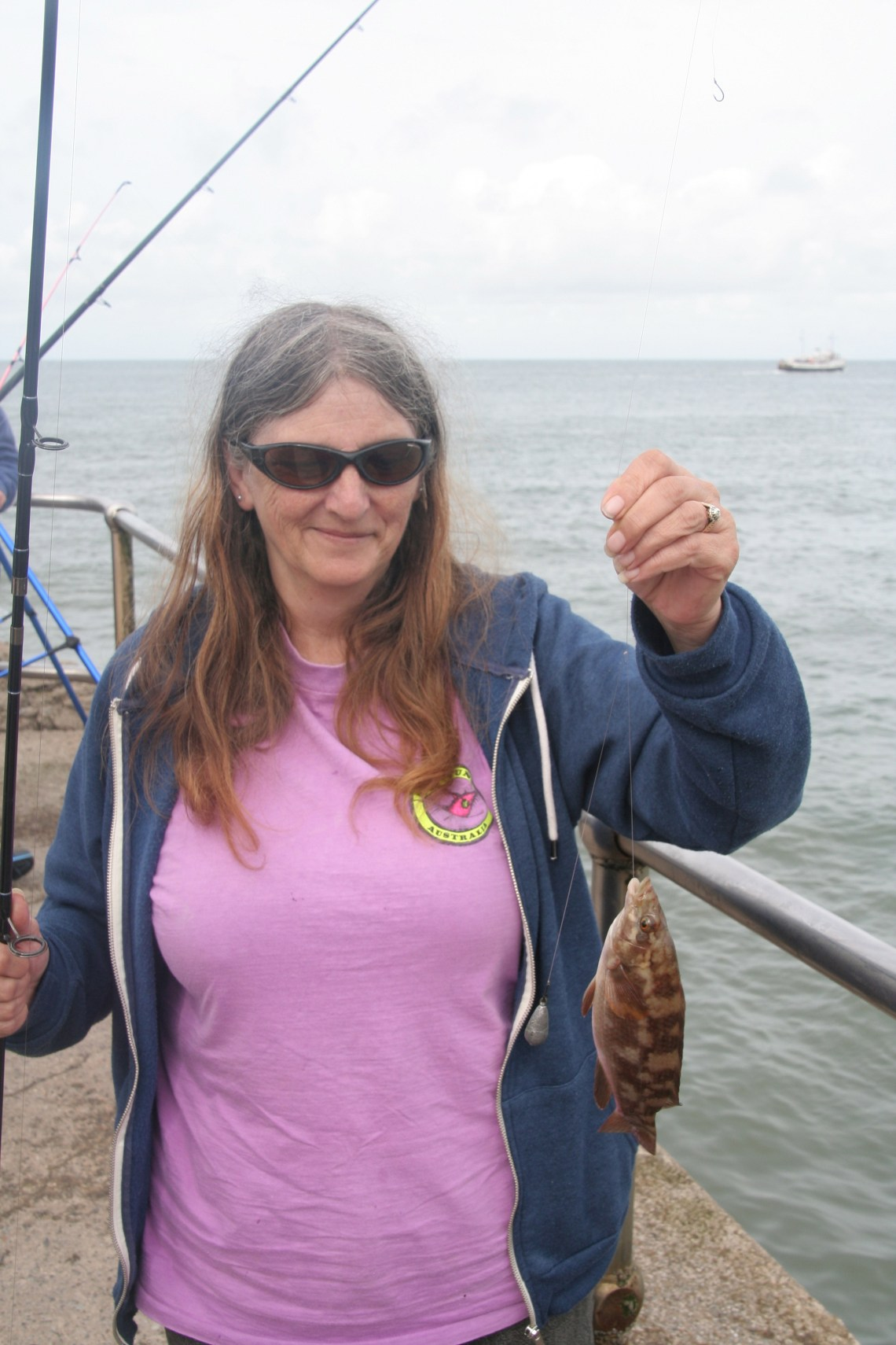 Lyn Wilson with the first fish of the day.