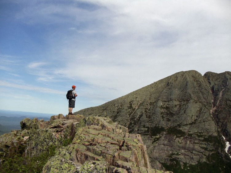 Hiker admiring the view of Katahdin's Knife Edge from the Cathedral Trail.