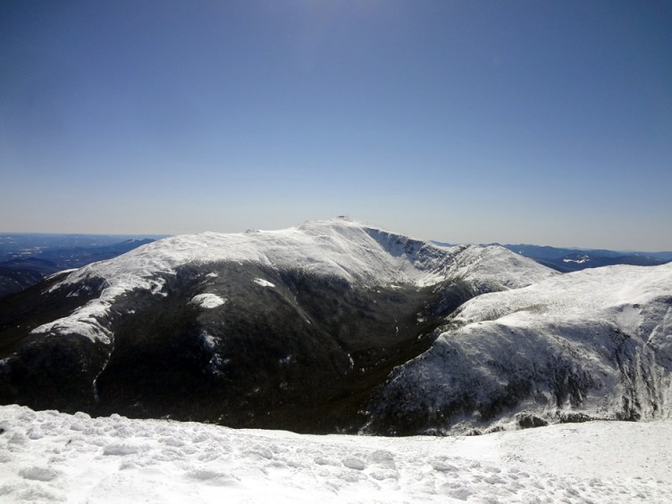 The winter view of Mt. Washington as seen from the summit of Mt. Adams in New Hampshire.