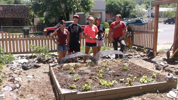 Mayor's Youth Advisory Committee plants in St. John's garden