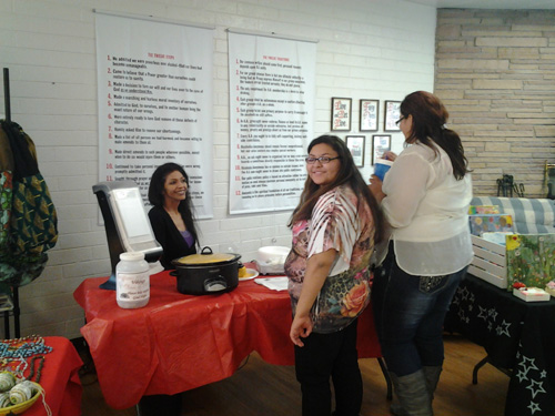 Youth from the Williams High School sell food to support their safe school party.