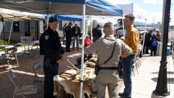 Officers of Arizona Game and Fish and Department of Public Safety at the Game and Fish display.