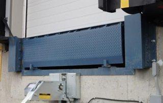 Steel face dock bumper with Dock Leveler and AR-20K Trailer Restraint