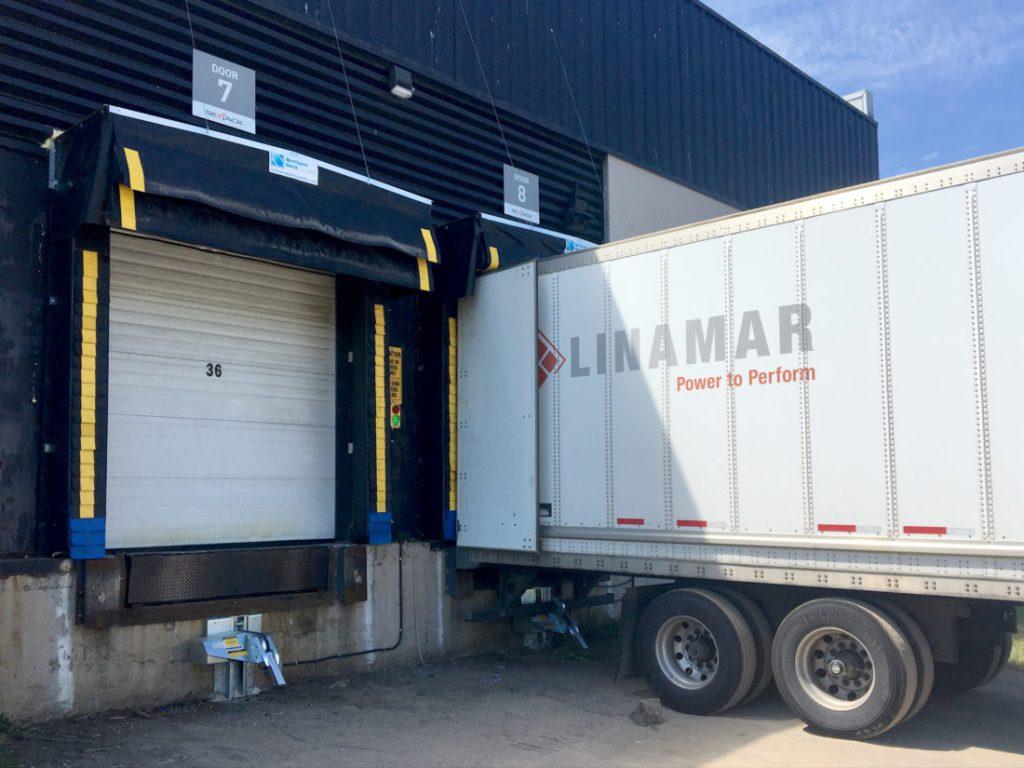 Skyjack K1 Storage Facility – Trailer Restraint and Rain Deflector Truck Shelter