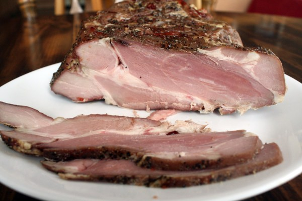 Cured and smoked cottage bacon, before being fried.
