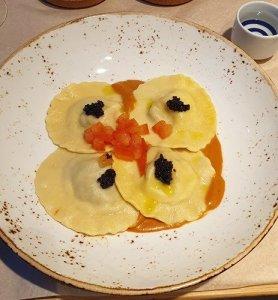Lobster Ravioli with bisque and caviar paired with 'Umakara Mansaku' Tokubetsu Junmai.