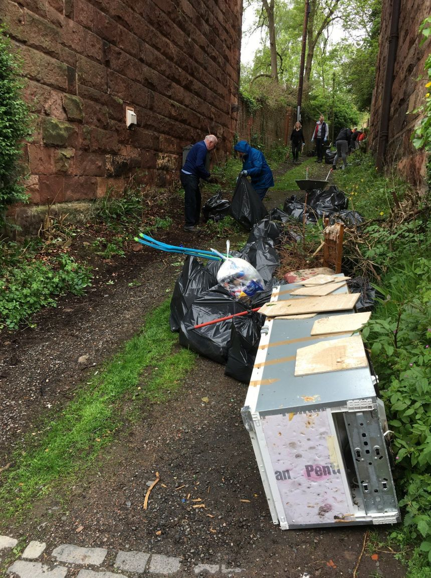 Volunteers clearing up rubbish in the lane.