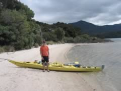 Standing in front of the Kayak