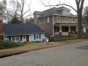 Image result for image of a mcmansion next to a small house