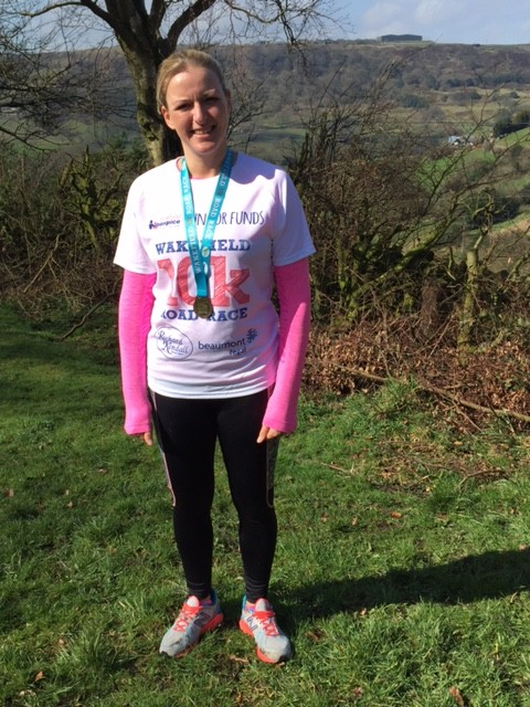 Holly with finishers medal and t-shirt