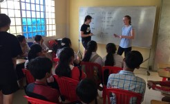 Community service group of students teaching English in Cambodia
