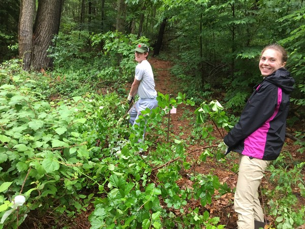 Chas and Kristen removing invasives from trailhead