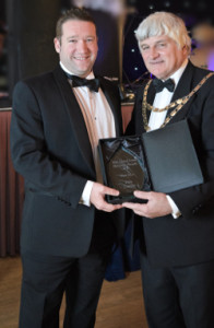 Rob Vivian MD of Pure Comms receiving his award