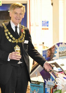 Councillor Raymond Armstrong, the Mayor of Weston-super-Mare cutting the ribbon at the opening ceremony of new showroom.