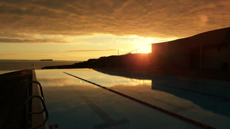 Hofsós swimming pool offers a uniques view over Drangey and Skagafjörður bay