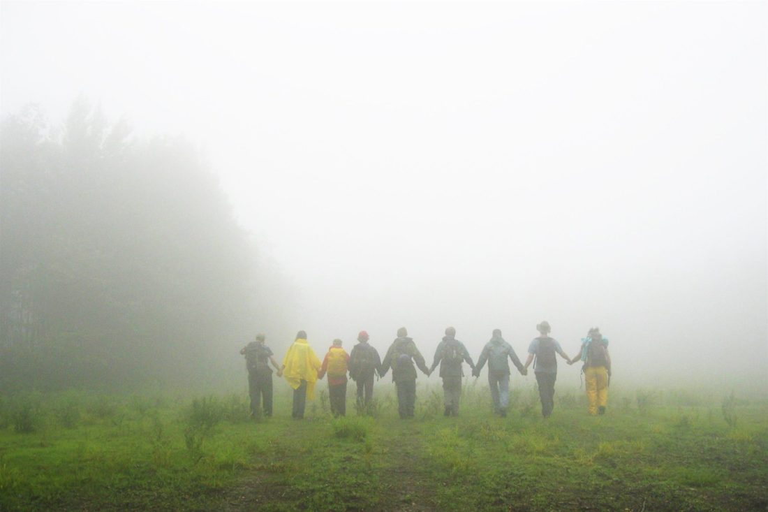 BC People, Whole Backcountry Crew walking into mist