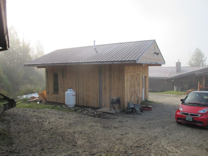 The new boiler shed, built with a large roof overhand to accommodate plenty of wood storage.
