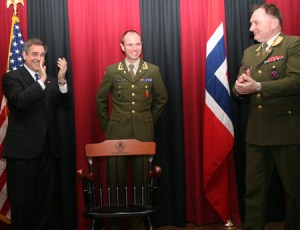 Ambassador Whitney (left) and Chief of Defense Diesen (right) honored the outstanding master student Daltveit. The chair was a gift from the U.S. Office of Defense Cooperation at the Embassy.